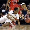 California's Afure Jemerigbe, left, and Georgia's Tiaria Griffin dive for a loose ball during the first half in a regional final in the NCAA women's college basketball tournament, Monday, April 1, 2013, in Spokane, Wash. (AP Photo/Elaine Thompson)