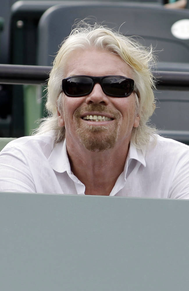 Richard Branson sits courtside at the Sony Open tennis tournament in Key Biscayne, Fla., Thursday, March 27, 2014