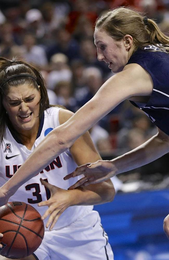 Connecticut's Stefanie Dolson (31) is fouled by BYU's Jennifer Hamson (5) during the second half of a regional semifinal in the NCAA college basketball tournament in Lincoln, Neb., Saturday, March 29, 2014