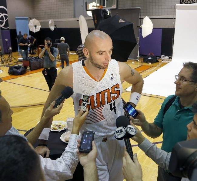 Phoenix Suns' Marcin Gortat (4), of Poland, speaks with reporters during the team's NBA basketball media day on Monday, Sept. 30, 2013, in Phoenix