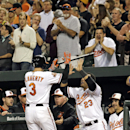 Baltimore Orioles' Ryan Flaherty (3) high-fives teammate Nelson Cruz after hitting a two-run home run in the fourth inning of a baseball game against the Toronto Blue Jays, Monday, Sept. 15, 2014, in Baltimore. (AP Photo/Patrick Semansky)