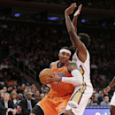 New York Knicks forward Carmelo Anthony, left, drives up against New Orleans Pelicans forward Al-Farouq Aminu in the second half of an NBA basketball game in New York, Sunday, Dec. 1, 2013. Anthony scored only 23 points as the Pelicans defeated the Knick