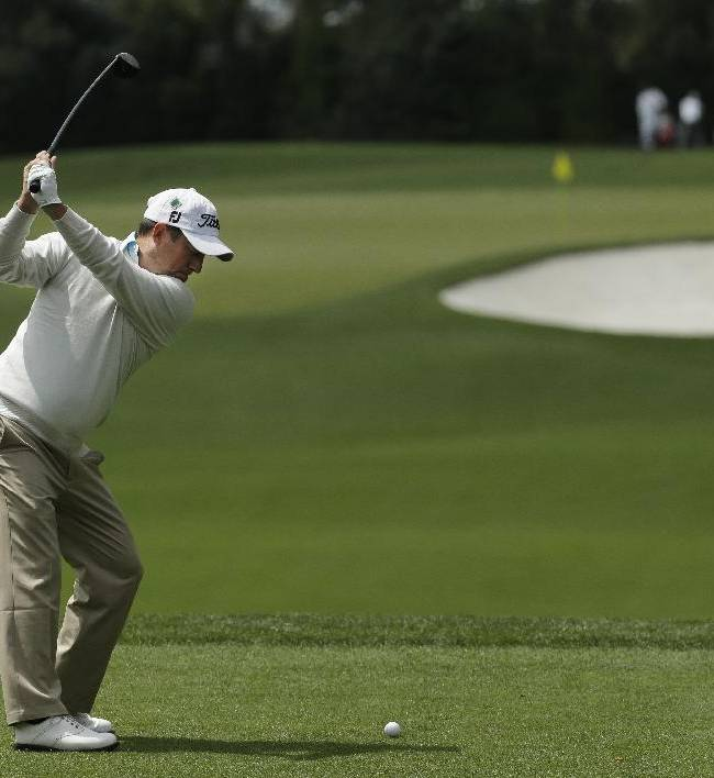 Darren Clarke, of Northern Ireland, tees off on the fourth hole during a practice round for the Masters golf tournament Tuesday, April 8, 2014, in Augusta, Ga