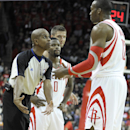 Referee Sean Corbin, left, tells Houston Rockets' Dwight Howard (12) why he was called for a technical foul against the Brooklyn Nets in the first half of an NBA basketball game on Friday, Nov. 29, 2013, in Houston. Rockets' Aaron Brooks (0) and Chandler