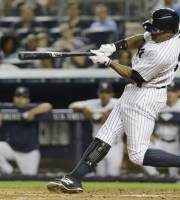 New York Yankees' Curtis Granderson hits an RBI single during the third inning of a baseball game against the Toronto Blue Jays on Wednesday, Aug. 21, 2013, in New York. (AP Photo/Frank Franklin II)