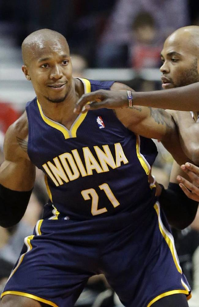 Indiana Pacers forward David West (21) looks to a pass as Chicago Bulls forward Taj Gibson (22) and forward Luol Deng (9) guard during the first half of an NBA preseason basketball game in Chicago on Friday, Oct. 18, 2013
