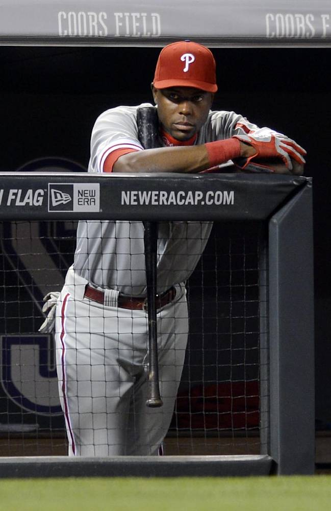 Philadelphia Phillies' Tony Gwynn looks on from the dugout against the Colorado Rockies during the seventh inning of a baseball game on Friday, April 18, 2014, in Denver