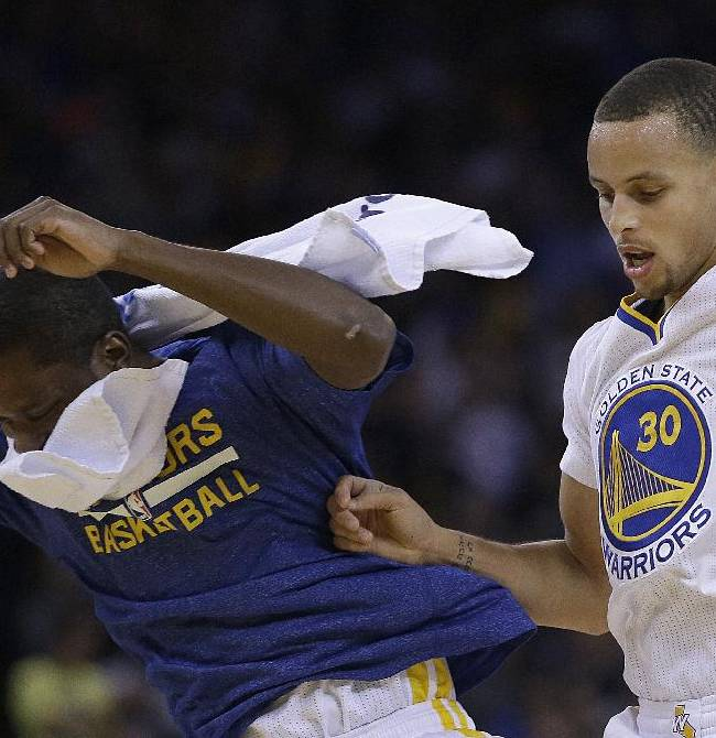 Golden State Warriors' Toney Douglas, left, and Stephen Curry (30) celebrate during the second half of an NBA basketball game against the Sacramento Kings, Saturday, Nov. 2, 2013, in Oakland, Calif