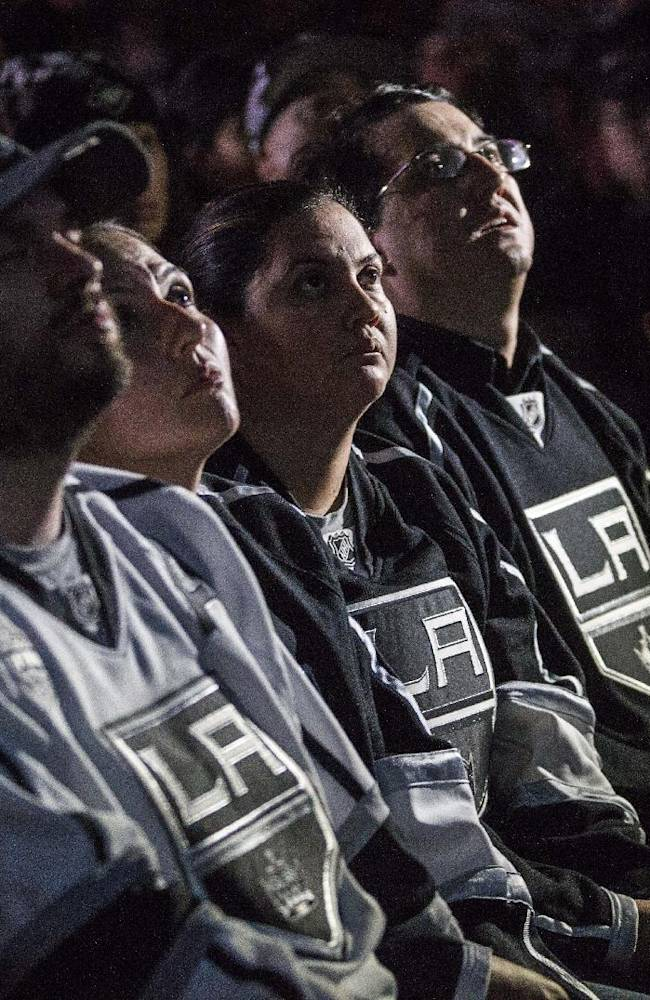 Los Angeles Kings fans react at Club Nokia at L.A. LIVE during Game 4 of the NHL hockey Stanley Cup Finals against the New York Rangers, Wednesday, June 11, 2014. The Rangers defeated the Kings 2-1