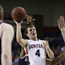 Gonzaga's Kevin Pangos (4) attempts a layup during the first half of an NCAA college basketball game against St. Mary's on Thursday, Jan. 2, 2014, in Spokane, Wash. (AP Photo/Young Kwak)