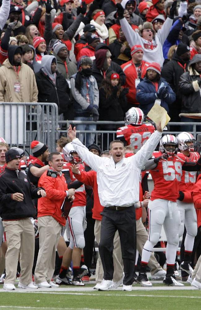 In this Nov. 24, 2012 file photo, Ohio State head coach Urban Meyer celebrates as time runs off the clock in their 26-21 win over Michigan in an NCAA college football game in Columbus, Ohio. It has already been a successful season for No. 3 Ohio State, but as the Buckeyes know, no season is a success if they lose to their chief rivals, the Michigan Wolverines