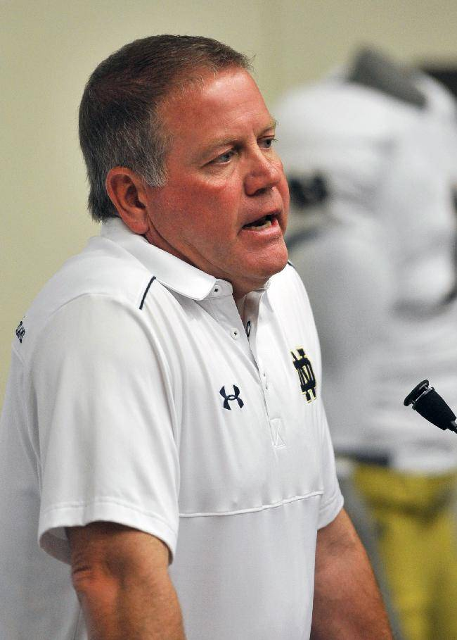 Notre Dame coach Brian Kelly talks to the media during media day for the NCAA college football team Tuesday Aug. 19, 2014,  in South Bend, Ind