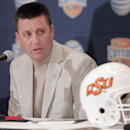 Oklahoma State head football coach Mike Gundy speaks to the media during an NCAA college football news conference, Thursday, Jan. 2, 2014, in Irving, Texas. Oklahoma State will play Missouri in the Cotton Bowl on Friday in Arlington, Texas The Associated