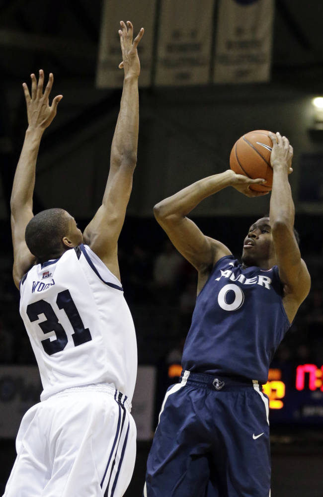 Xavier guard Semaj Christon (0) pulls up for a shot over Butler forward Kameron Woods in the second half of an NCAA college basketball game in Indianapolis, Tuesday, Feb. 11, 2014
