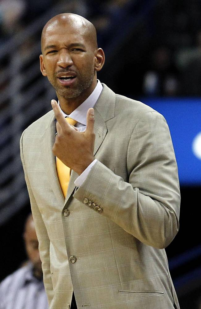 New Orleans Pelicans head coach Monty Williams reacts in the first half of an NBA basketball game against the Philadelphia 76ers in New Orleans, Saturday, Nov. 16, 2013