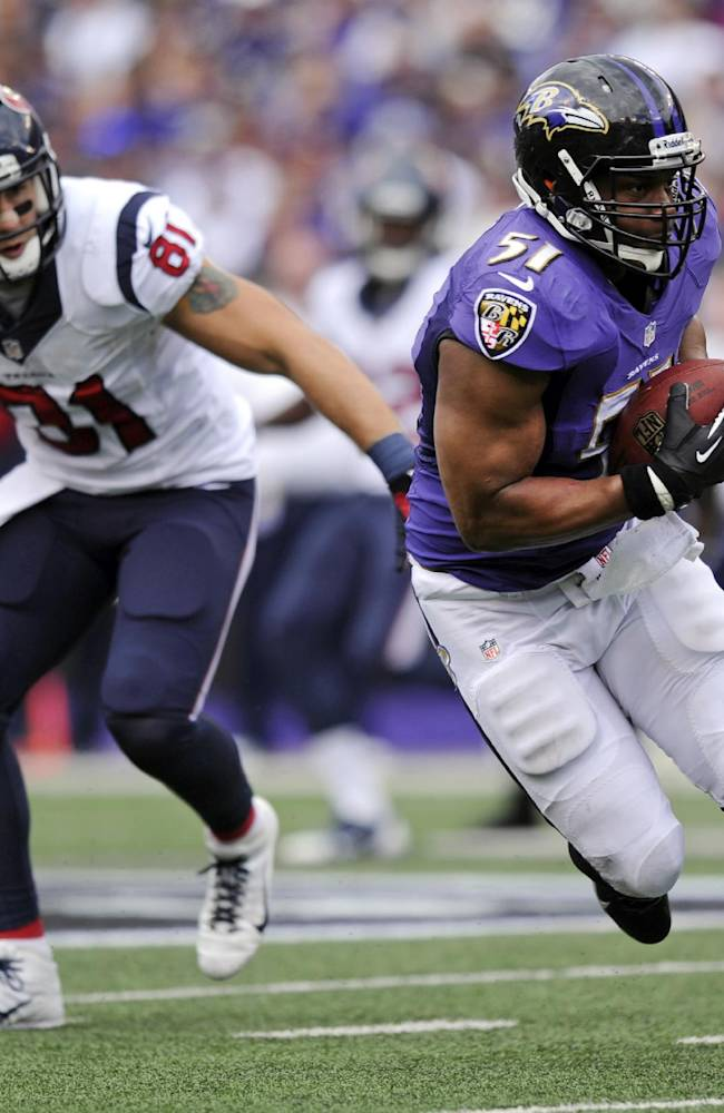In this Sept. 22, 2013, file photo, Baltimore Ravens inside linebacker Daryl Smith, right, intercepts a pass in front of Houston Texans tight end Owen Daniels before returning it for a touchdown in the first half of an NFL football game in Baltimore. As the new man in the middle of the Ravens defense, Smith has no desire to be compared to Ray Lewis. That doesn't mean he doesn't possess some of the same qualities as the man he replaced