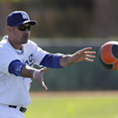 Los Angeles Dodgers' Adrian Gonzalez tosses a heavy ball during spring training baseball practice Thursday, Feb. 20, 2014, in Glendale, Ariz The Associated Press