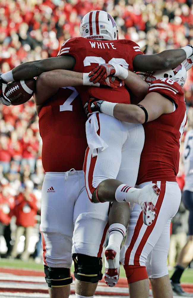 White has fun time in end zone for No. 17 Badgers