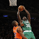 Boston Celtics' Brandon Bass (30) shoots over New York Knicks' Metta World Peace (51) during an NBA basketball game on Sunday, Dec. 8, 2013, in New York. The Celtics won 114-73 The Associated Press