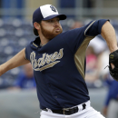 San Diego Padres starting pitcher Ian Kennedy works against the Texas Rangers in the first inning of a spring training baseball game on Thursday, March 6, 2014, in Peoria, Ariz. The Rangers won 8-4 The Associated Press