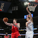 Houston Rockets center Omer Asik, left, ot Turkey, pulls in rebound as Denver Nuggets center Timofey Mozgov, of Russia, covers in the third quarter of the Nuggets' 123-116 victory in an NBA basketball game in Denver on Wednesday, April 9, 2014 The Associa
