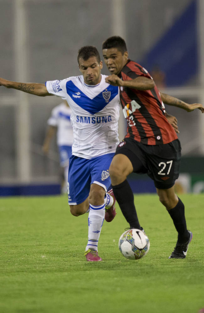Matias Mirabaje of Argentina's Velez Sarsfield, left, vies for the ball with Matias Mirabaje of Brazil's Atletico Paranaense during a Copa Libertadores soccer match in Buenos Aires, Argentina, Tuesday, Feb. 25, 2014