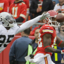 Oakland Raiders cornerback D.J. Hayden (25) stretches but can't reach an incomplete pass to Kansas City Chiefs wide receiver Dwayne Bowe, right, during the first half of an NFL football game in Kansas City, Mo., Sunday, Dec. 14, 2014 The Associated Press