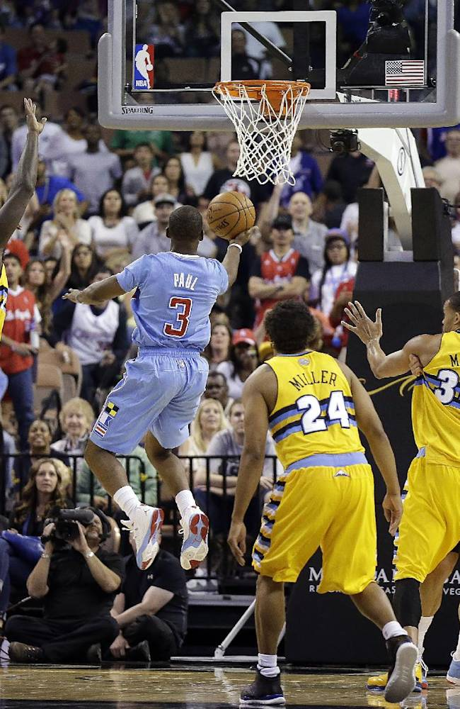 The Los Angeles Clippers' Chris Paul sinks a game-tying shot during the final seconds of the second half of a preseason NBA basketball game against the Denver Nuggets on Saturday, Oct. 19, 2013, in Las Vegas. The Clippers went on to defeat the Nuggets in overtime 118-111
