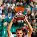 Stanislas Wawrinka of Switzerland holds his trophy after defeating Roger Federer of Switzerland in their...</p>