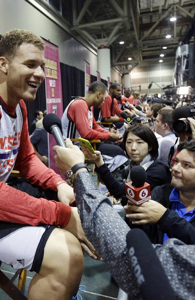 Team West's Blake Griffin, of the Los Angeles Clippers, laughs during a media availability at NBA All-Star game basketball practice in New Orleans, Saturday, Feb. 15, 2014