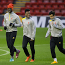 Liverpool's Mario Balotelli, left, trains with teammates Raheem Sterling, center, and Philippe Coutinho at Anfield Stadium, in Liverpool, England, Tuesday, Oct. 21, 2014. Liverpool will play Real Madrid in a Champion's League Group B soccer match on Wedne