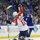 Florida Panthers center Jonathan Huberdeau (11) celebrates after scoring past Tampa Bay Lightning goalie Ben Bishop (30), defenseman Jason Garrison (5) and defenseman Radko Gudas (7), of the Czech Republic, during the third period of an NHL hockey game Th