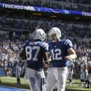 Indianapolis Colts wide receiver Reggie Wayne celebrates a touchdown against the Tennessee Titans with quarterback Andrew Luck during the second half of an NFL football game in Indianapolis, Sunday, Sept. 28, 2014. (AP Photo/Darron Cummings)