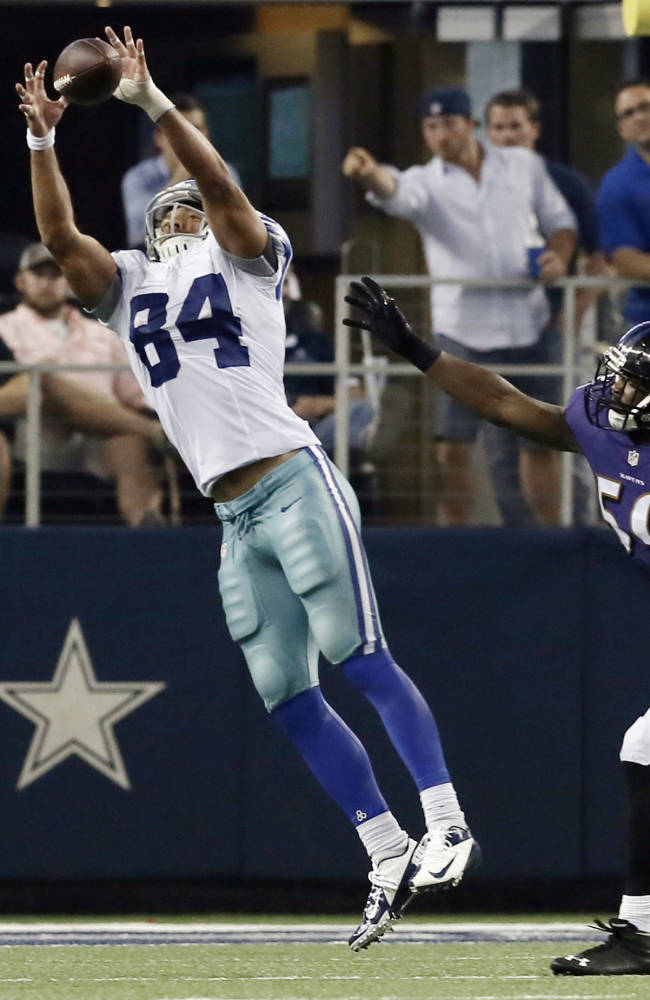 Dallas Cowboys tight end James Hanna (84) makes a catch against Baltimore Ravens defensive back Brynden Trawick (28) and inside linebacker Arthur Brown (59) for a touchdown play during the second half of an NFL preseason football game Saturday, Aug. 16, 2014, in Arlington, Texas