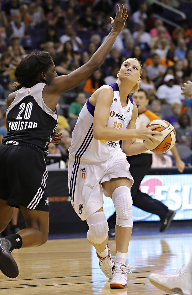 Phoenix Mercury's Penny Taylor, right, drives past San Antonio Silver Stars' Shameka Christon (20) during the second half of a WNBA basketball game, Friday, Sept. 13, 2013, in Phoenix