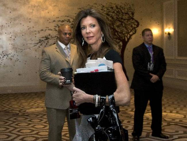 Dallas Cowboys football team Executive Vice President Charlotte Jones Anderson arrives for the NFL fall meeting in Washington, Tuesday, Oct. 8, 2013