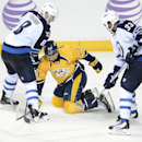 Winnipeg Jets defenseman Jacob Trouba (8) and Dustin Byfuglien (33) knock the puck away from Nashville Predators forward Simon Moser (21), of Switzerland, in the third period of an NHL hockey game on Saturday, March 1, 2014, in Nashville, Tenn. The Jets w