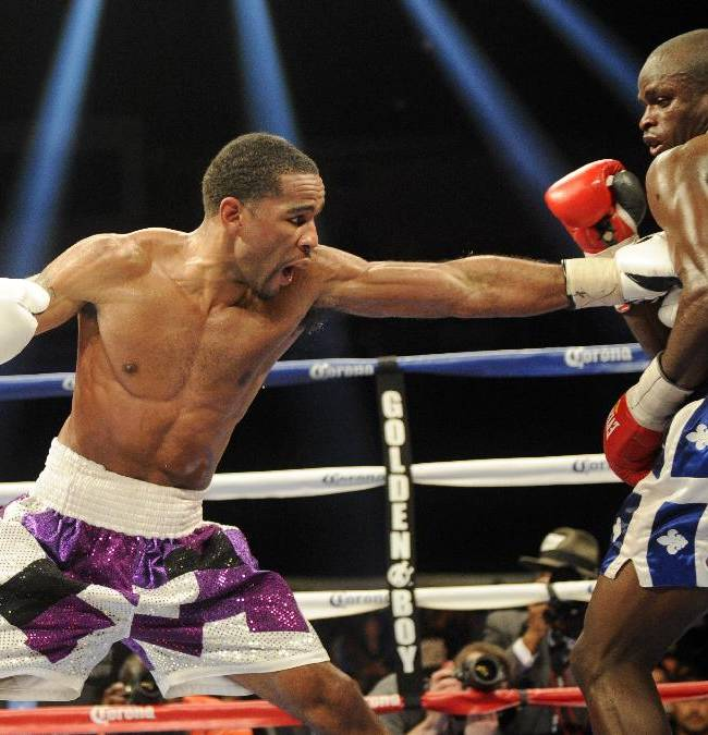 Lamont Peterson, left, throws a punch at  Dierry Jean, right, of Canada, during the IBF Junior welterweight title boxing match, Saturday, Jan. 25, 2014, in Washington. Peterson won the match