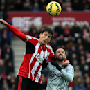 Sunderland's Santiago Vergini, left, vies for the ball with Burnley's Danny Ings, right, during their English Premier League soccer match between Sunderland and Burnley at the Stadium of Light, Sunderland, England, Saturday, Jan. 31, 2015