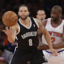 New York Knicks' Raymond Felton (2) defends Brooklyn Nets' Deron Williams (8) during the first half of an NBA basketball game Wednesday, April 2, 2014, in New York The Associated Press