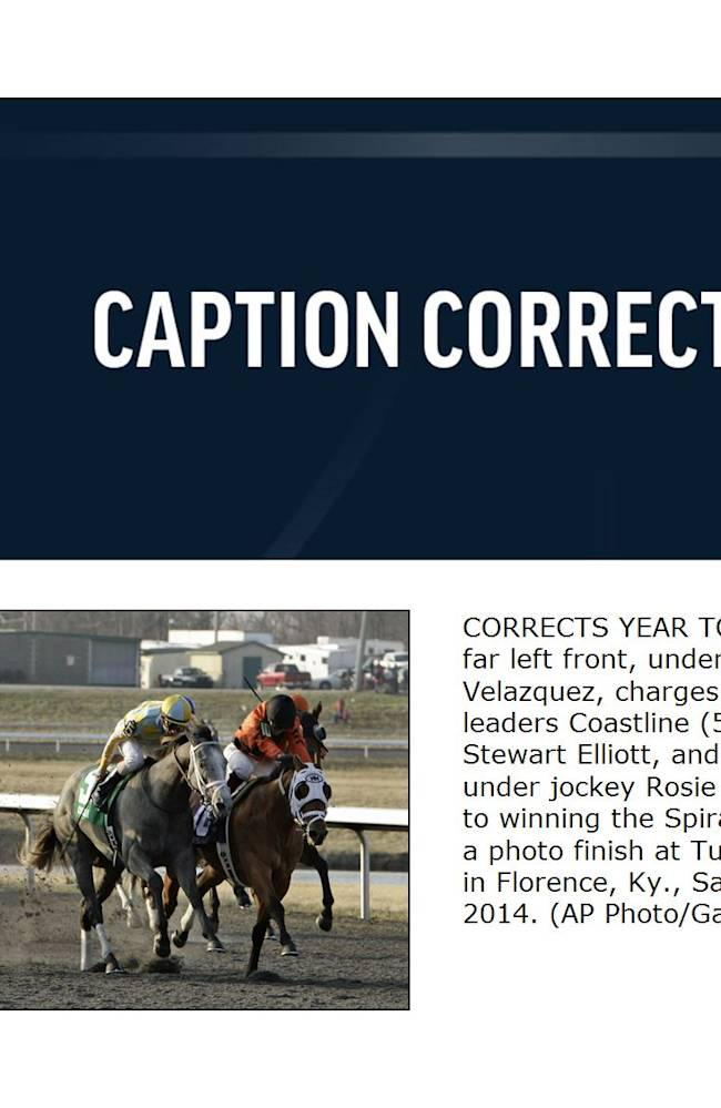 CORRECTS YEAR TO 2014 - We Miss Artie, far left front, under jockey John Velazquez, charges on the outside toward leaders Coastline (5), under jockey Stewart Elliott, and Harry's Holiday (10), under jockey Rosie Napravnik, on its way to winning the Spiral Stakes horse race in a photo finish at Turfway Park race track in Florence, Ky., Saturday, March 22, 2014
