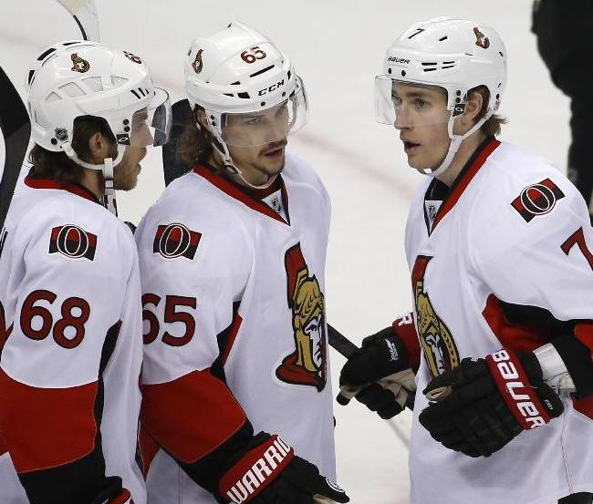 Ottawa Senators' Kyle Turris (7) celebrates his goal with teammates Erik Karlsson (65) and Mike Hoffman (68) in the first period of an NHL hockey game against the Pittsburgh Penguins in Pittsburgh, Sunday, April 13, 2014