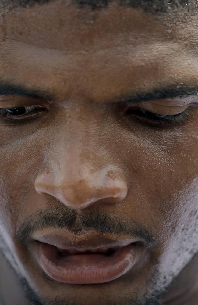 In this June 6, 2014, file photo, St. Louis Rams defensive end Michael Sam speaks to the media following an organized team activity at the NFL football team's practice facility in St. Louis. Sam, the first openly gay player drafted by an NFL team, was released by the Rams Saturday, Aug. 30, 2014