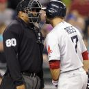 Boston Red Sox Cody Ross, right, gets close to home umpire Adrian Johnson after Ross was called out on strikes looking against the Seattle Mariners in the fifth inning of a baseball game Thursday, June 28, 2012, in Seattle. (AP Photo/Elaine Thompson)