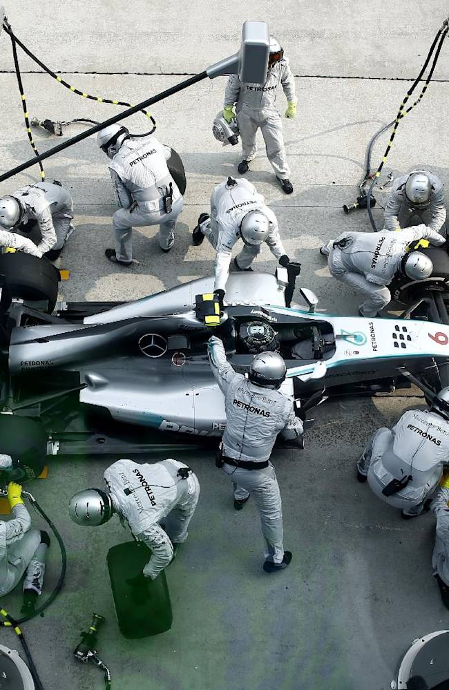 The pit crew for Mercedes driver Nico Rosberg of Germany change his tires during the Malaysian Formula One Grand Prix at Sepang International Circuit in Sepang, Malaysia, Sunday, March 30, 2014