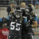 Jacksonville Jaguars outside linebacker Geno Hayes (55) celebrates his interception with teammate linebacker J.T. Thomas (52) during the fourth quarter of an NFL football game against the Houston Texans Thursday, Dec. 5, 2013, in Jacksonville, Fla The Ass