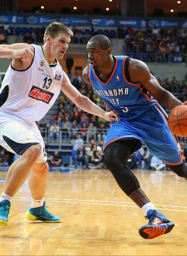 Oklahoma City Thunder's Serge Ibaka, right, goes for a basket as Gasper Vidmar of Fenerbahce Ulker defends during a basketball game in Istanbul, Turkey, Saturday, Oct. 5, 2013. Oklahoma City Thunder has opened the preseason schedule with a game against five-time Turkish champion at the Ulker Sports Arena.(AP Photo)