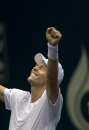 Tomas Berdych of the Czech Republic reacts after winning over Gilles Simon of France during their semifinal match of the Thailand Open tennis tournament in Bangkok Saturday, Sept. 28, 2013. Berdych beat Simon 6-7,6-2,7-5. (AP Photo/Sakchai Lalit)
