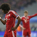 Bayern's Dante touches his forehead after clashing with Manchester United's Wayne Rooney during the Champions League quarterfinal second leg soccer match between Bayern Munich and Manchester United in the Allianz Arena in Munich, Germany, Wednesday, April