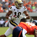 UCLA Bruins defensive back Jalen Ortiz (18) runs the ball in front of Virginia linebacker Tyler Shirley (42) during the second half of an NCAA college football game at Scott Stadium, Saturday, Aug. 30, 2014, in Charlottesville, Va. UCLA Bruins defeated Virginia 28-20. (AP Photo/Andrew Shurtleff)